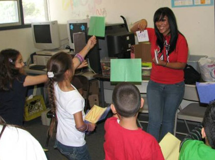 Picture of ELACYC children enjoying the goofy grammar game, led by CSULA student Tania Varona.