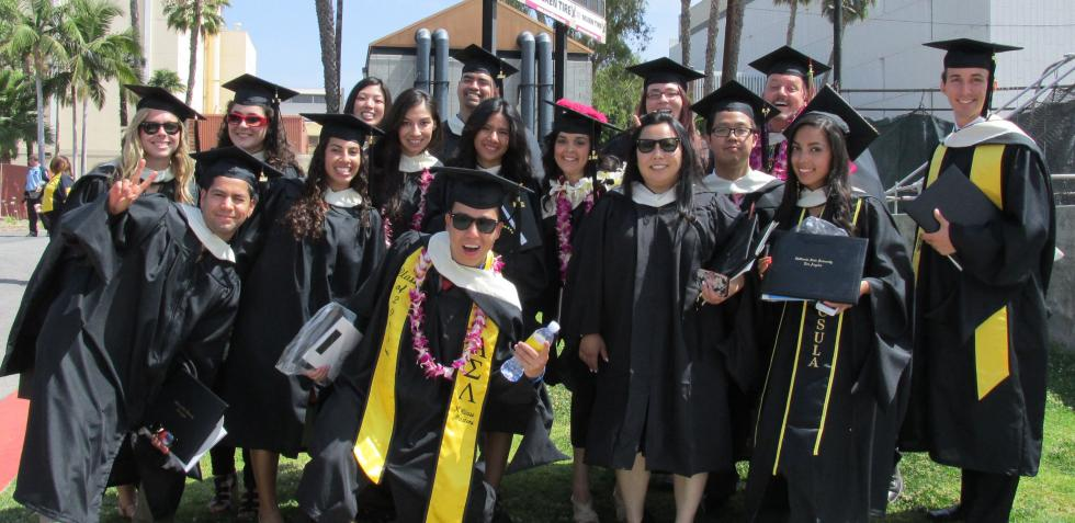 Psychology alumni pose for a photograph following their graduation ceremony.