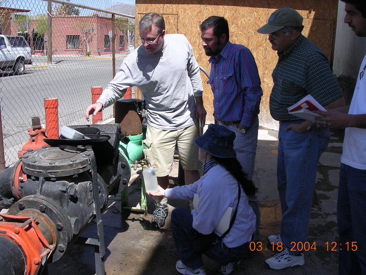 Barry Hibbs sampling water well with colleagues in Ciudad Juarez