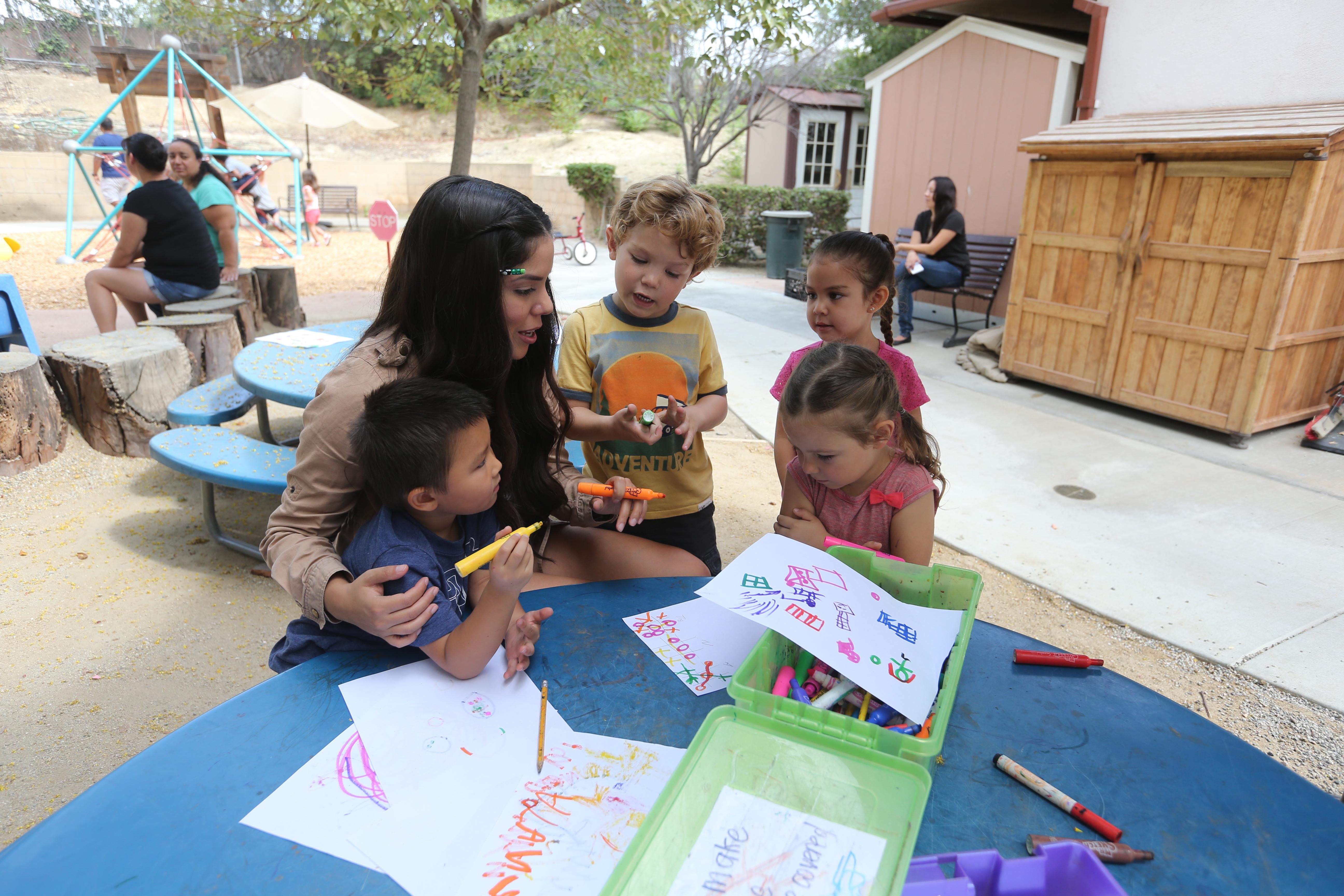 Teacher working with children
