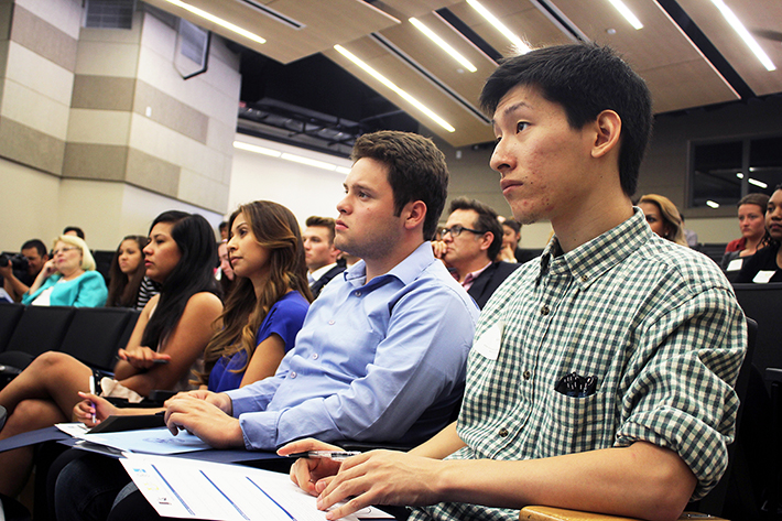 Cal State L.A. student Kevin Chong, right, listens to a lecture on influencing government at Civic University.