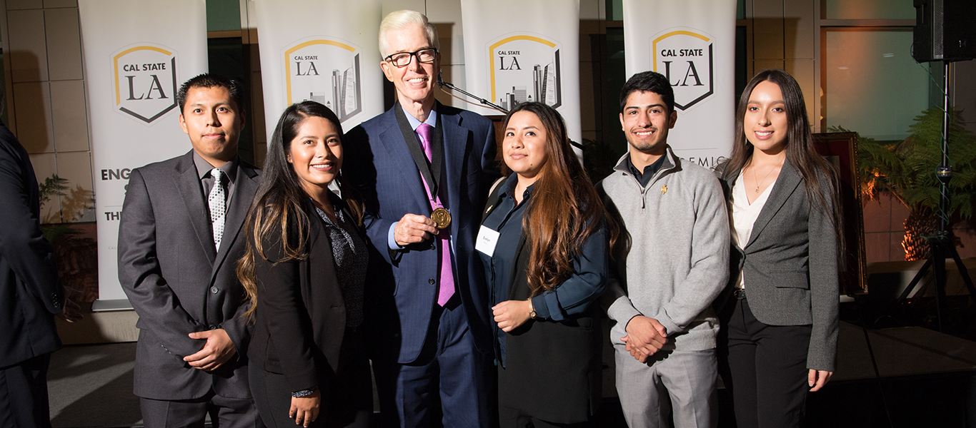 Five Criminal Justice undergraduate students with former Governor of California, Gray Davis at the HDFSC 10th year Anniversary