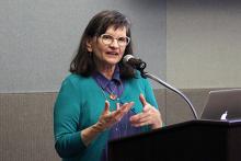 Kim Abeles speaks at microphone