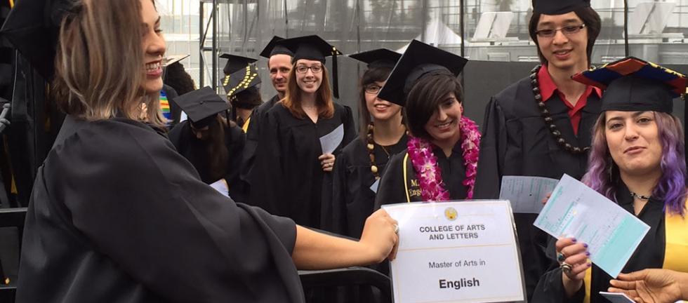 MA students celebrating their graduation.