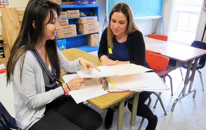 Alumna Jacqueline Jurado, a speech therapist with Los Angeles Unified School District, mentors student Selene Aguirre.