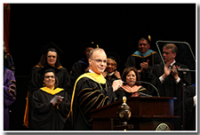 President William A. Covino accepts applause from the crowd.
